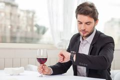 Attractive young businessman is waiting for his Stock Images