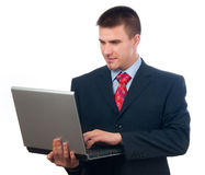 Attractive young businessman working on notebook Stock Photos