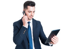 Attractive young businessman working using cellphone and digital Royalty Free Stock Photos
