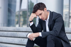 Attractive young businessman is worrying about his Stock Images