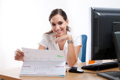 Attractive young businesswoman checking her schedule Royalty Free Stock Photos