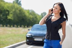 Attractive young businesswoman is communicating on Stock Photography