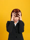 Attractive, young businesswoman having a head ache Royalty Free Stock Image