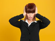 Attractive, young businesswoman having a head ache Stock Photo