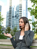 Attractive young businesswoman with headset Stock Images