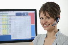 Attractive Young Businesswoman with a Headset Stock Photo