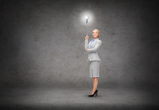 Attractive young businesswoman with her finger up Stock Images