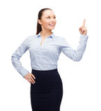 Attractive young businesswoman with her finger up Royalty Free Stock Images