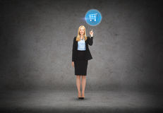 Attractive young businesswoman with her finger up Royalty Free Stock Photos