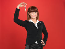 Attractive, young businesswoman holding house keys Stock Photo
