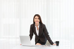 Attractive young businesswoman and Laptop working in office Royalty Free Stock Photography