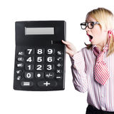 Woman with large calculator Stock Photo