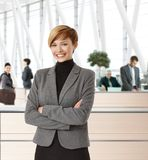Attractive young businesswoman in office hallway Stock Photography