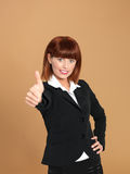 Attractive, young businesswoman showing ok sign Royalty Free Stock Photography