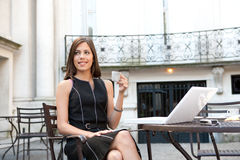 Businesswoman with laptop in cafe. Stock Photo