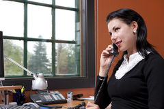 Attractive Young Businesswoman Talking On Phone Stock Image