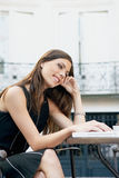 Businesswoman with laptop in cafe. Stock Photography