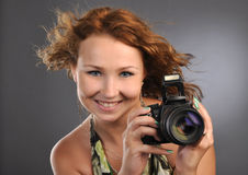 Attractive young cameragirl photographer stock photo