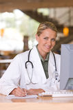 Attractive young caring doctor Royalty Free Stock Photos