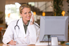 Attractive young caring doctor Stock Photos