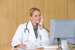 Attractive young caring doctor Royalty Free Stock Image