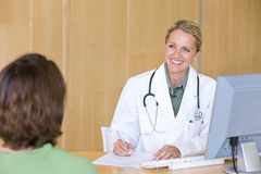 Attractive young caring doctor Royalty Free Stock Photo