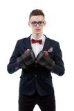 Attractive young caucasian businessman wearing boxing gloves. Royalty Free Stock Photo
