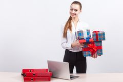 Picture of beautiful business lady holding the present boxes Stock Photos