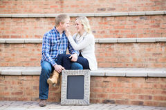 Attractive young caucasian couple smiling at each other Royalty Free Stock Photos