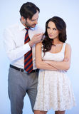 Attractive young Caucasian man tempting a woman Stock Image