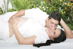 Attractive young caucasian pregnant couple in the park Royalty Free Stock Photo