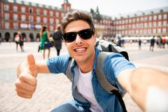 Handsome young caucasian tourist man happy and excited taking a selfie in Plaza Mayor, Madrid Spain. Attractive young caucasian tourist student man having fun Royalty Free Stock Image