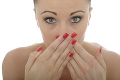 Attractive Young Caucasian Woman Covering Her Mouth In Shock And Stock Photos