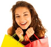 Attractive young caucasian woman with shopping bags isolated ove Royalty Free Stock Photography