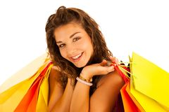 Attractive young caucasian woman with shopping bags isolated ove. R white background Stock Image