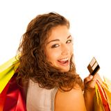 Attractive young caucasian woman with shopping bags isolated ove. R white background Royalty Free Stock Photo