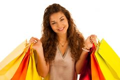 Attractive young caucasian woman with shopping bags isolated ove. R white background Royalty Free Stock Images