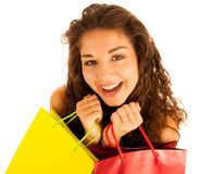 Attractive young caucasian woman with shopping bags isolated ove. R white background Royalty Free Stock Photography