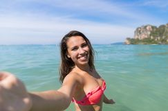 Attractive Young Caucasian Woman In Swimsuit On Beach Taking Selfie Photo, Girl Blue Sea Water Holiday Royalty Free Stock Image