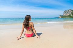 Attractive Young Caucasian Woman In Swimsuit Sitting On Beach Back Rear View, Girl Blue Sea Water Holiday Royalty Free Stock Images