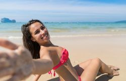 Attractive Young Caucasian Woman In Swimsuit Sitting On Beach, Girl Taking Selfie Photo Blue Sea Water Holiday. Summer Vacation Stock Images