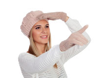 Attractive young caucasian woman in warm clothing pointing somet Royalty Free Stock Photo