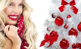 Woman winter christmas tree red balls Royalty Free Stock Photo