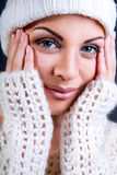 Attractive young caucasian woman in warm clothing Royalty Free Stock Images