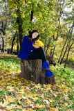 Attractive young caucasian woman in warm colorful clothing Royalty Free Stock Photo