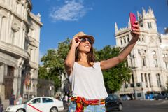Attractive young woman taking a selfie in Madrid, Spain Stock Image