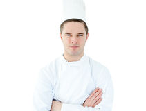 Attractive young chef with folded arms Royalty Free Stock Photo