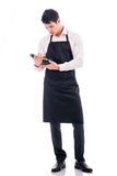Attractive young chef holding green champagne Royalty Free Stock Photo