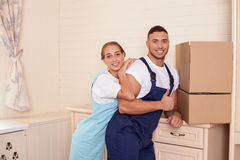 Attractive young cleaners are making fun during stock images