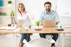 Attractive young colleagues have meeting with customer Royalty Free Stock Photo